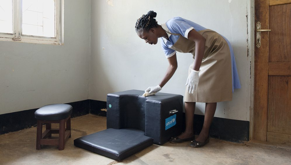 """Lorengechora, Karamoja (Uganda). Young midwife Fausta Abura is cleaning the """"birth cushion"""". Like the majority of the local midwives, Fausta studied in Matany Hospital, which is run by the Comboni missionaries."""