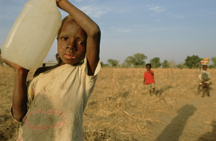 A boy with water collected from a well in northern Ghana. Each year, 443 million school days are lost across the developing world due to water-related illnesses, according to the UN