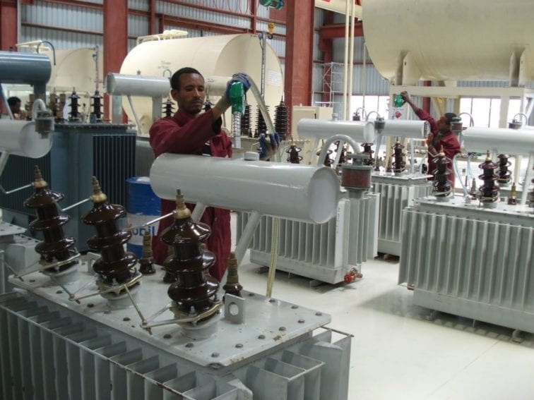 The transformer is filled with oil, which acts as a coolant. These transformers are for outside use only