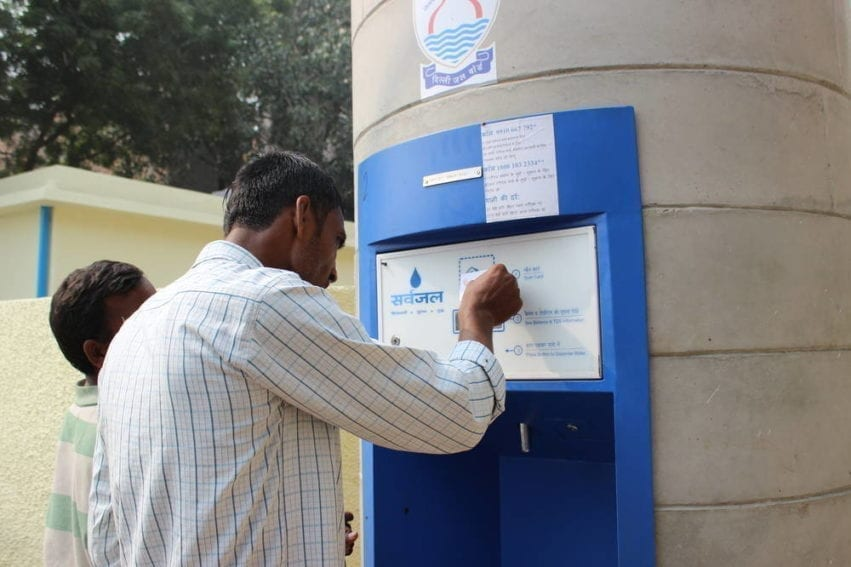 A user scans a prepaid Sarvajal smartcard, which will enable him to find out his remaining balance, the water quality and how much water can be withdrawn. Water can be collected 24 hours a day with this card. Each costs 100 rupees (about US$1.60), 50 of which is a security deposit, and can be topped up at the treatment plant