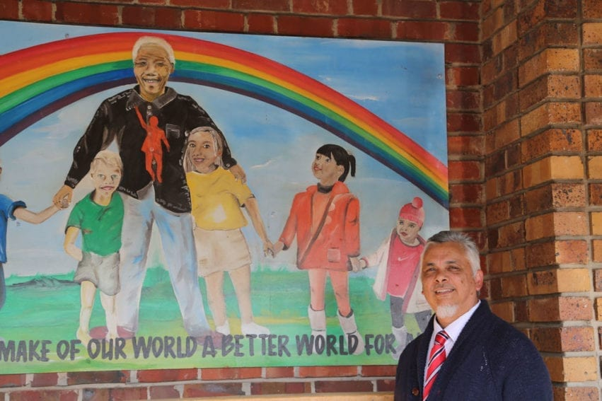 """A mural of Nelson Mandela on the school walls. Kannemeyer imbues with hope Mandela's famous words: """"Education is the most powerful tool which you can use to change the world"""""""