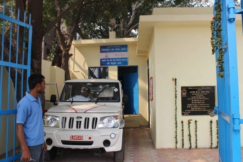 """The water begins its journey from this treatment centre run by Sarvajal, which means """"water for all"""" in Sanskrit. The company gets no direct financial help from the government, but has been granted permission to use the land rent free for ten years and draw groundwater from this location"""