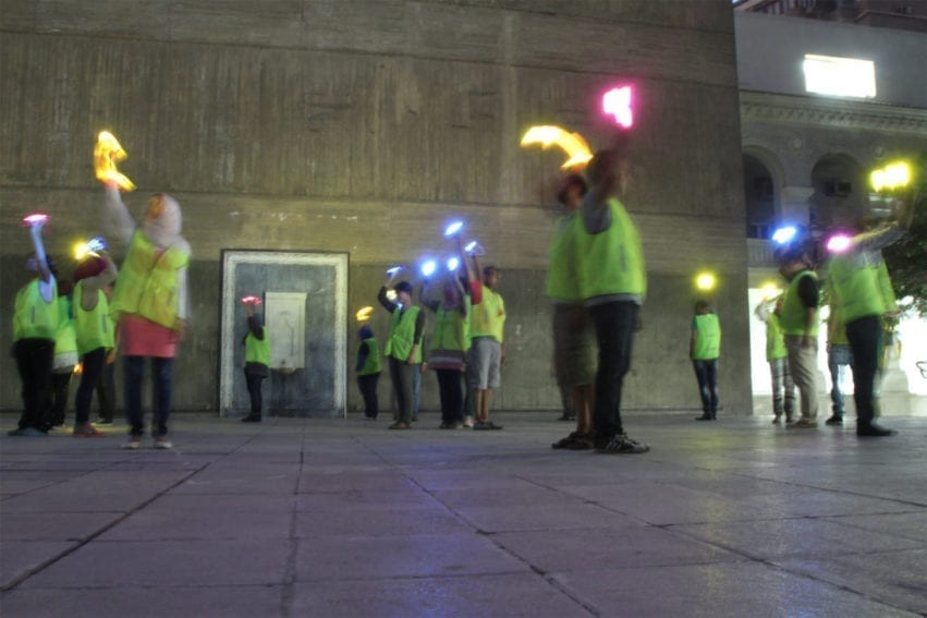 Cairo. For this performance, 21 volunteers from the Egyptians Against Coal association danced while holdingflash lights of different colours. Their movements formed the shape of the sun, with a wind-turbine motif at its centre. With their torches, they expressed a vision of Egypt's future built on sustainable energy.