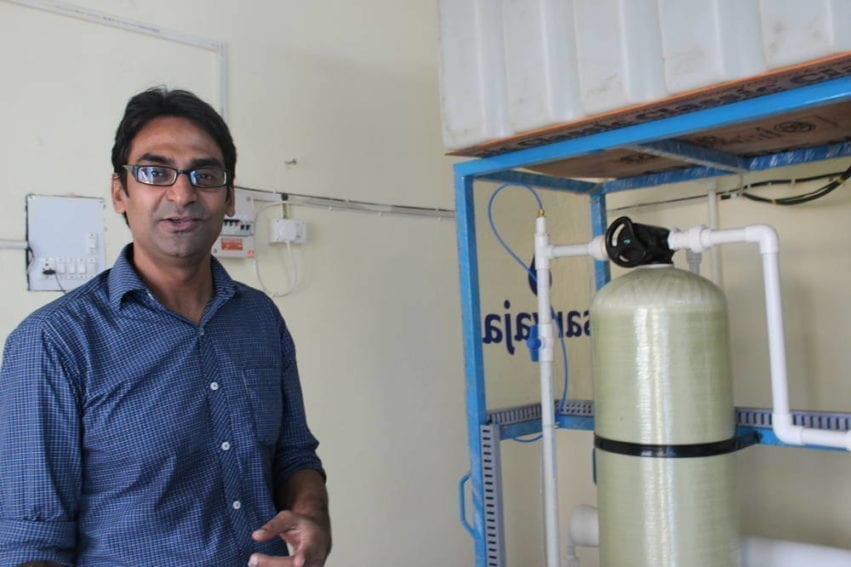 Amit Mishra, Sarvajal's operations manager in Delhi, explains that the poor quality groundwater in this location means it has to be left to settle for half an hour before being treated — and even then, it needs twice as much filtration as a typical installation