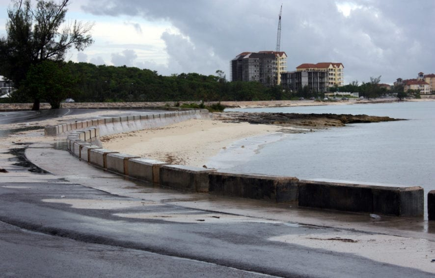 New Providence, Bahamas — a low-lying island where beaches are disappearing and the ocean encroaches onto the road. Yet hotel construction can be seen in the background, raising questions about the degree to which poor development contributes to coastline change by, for example, removing vegetation