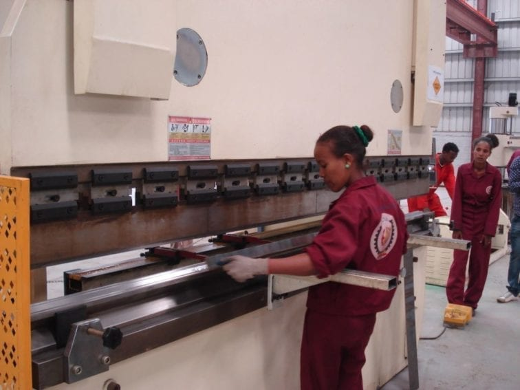 As a state company, the Tatek factory has a target to employ as many women as men. Women do much of the shaping and pressing work on the steel parts, which requires machine operation. Here, a steel plate is bent into a U-shape to hold cables in the final transformer