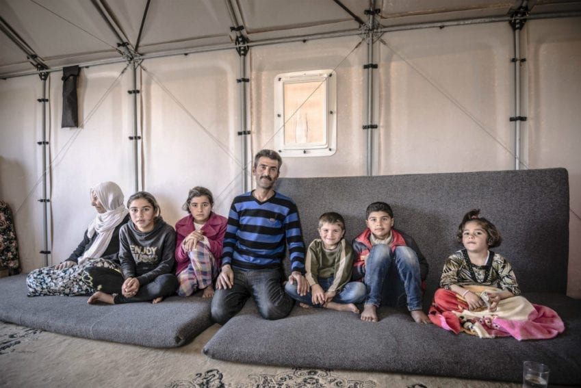 A family inside a prototype shelter in Kawergosk Refugee Camp, Iraq, in March. Refugee feedback has been crucial to the design process. Better Shelter interviewed former refugee camp residents now living in Sweden. Then it asked refugees about their cultural and environmental concerns during pilots in Ethiopia and Iraq