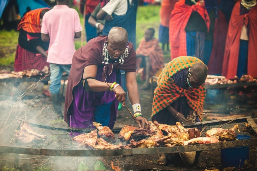 Meat being cooked at market. The handling of raw meat and the consumption of undercooked meat are key causes of infection. Medium-grilled meat is popular, increasing the risk of diseases being transmitted from animals to humans