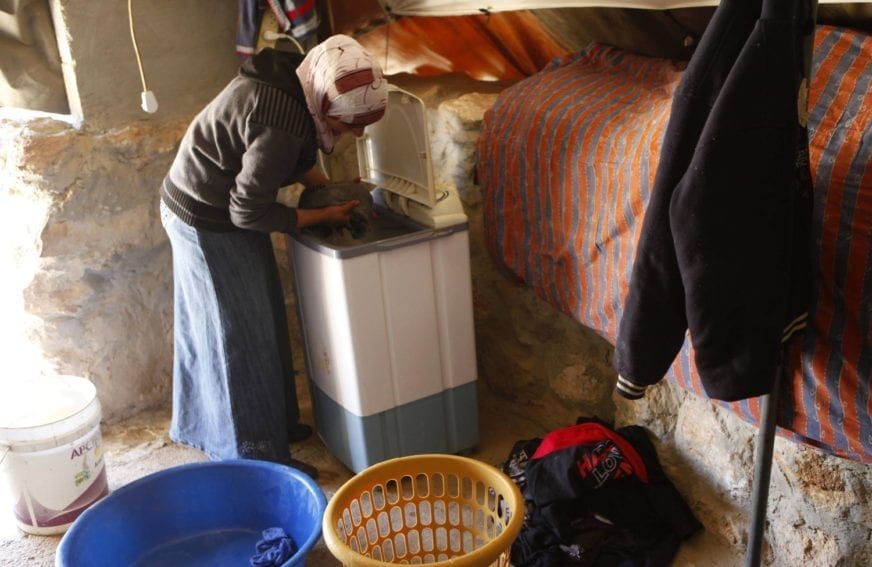 "Women also use renewable energy to run laundry machines, such as this one in a home in Sha'eb el Buttom. Electricity has ""revolutionised the lives of women"", Orian says, because they tend to do household tasks and take care of butter and cheese production."