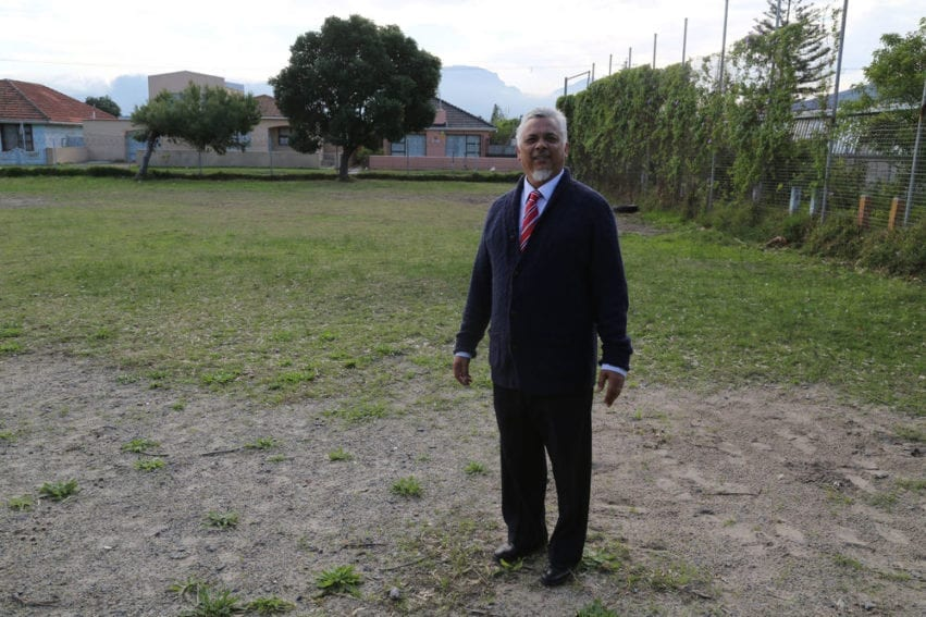 """Principal Ridwan Samodien stands at the site of the future school hall. """"Because of our difficult past not many schools have halls,"""" says Samodien. A partnership between private and public organisations and Kannymeyer, is funding the hall. As well as providing a new space for the kids, the local community will be able to use it"""
