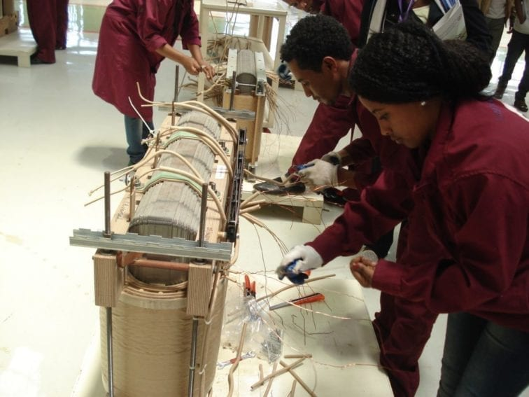 The final wiring of the transformer's inner section is done by hand. This is then welded into the transformer body, and three connectors are screwed to the top.