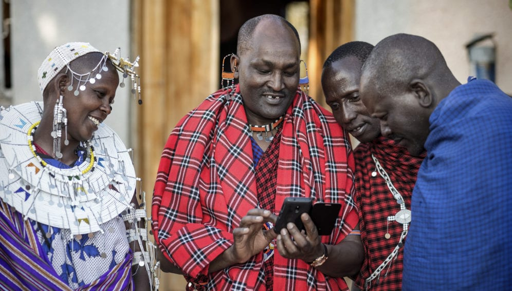 Indigenous man with smartphone
