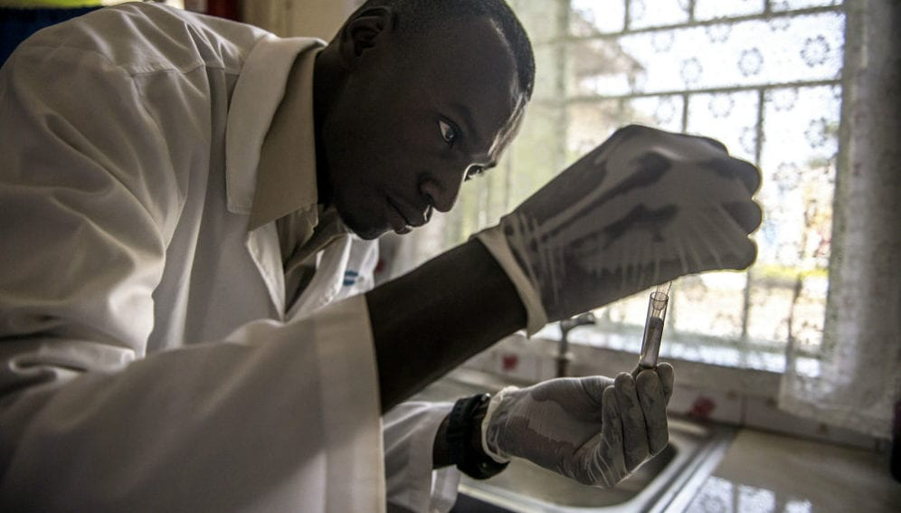 Laboratory technician Denis Bongoyinge prepares a blood sample