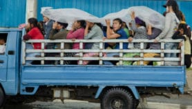 Mobile phone quiz educates Cambodian factory workers