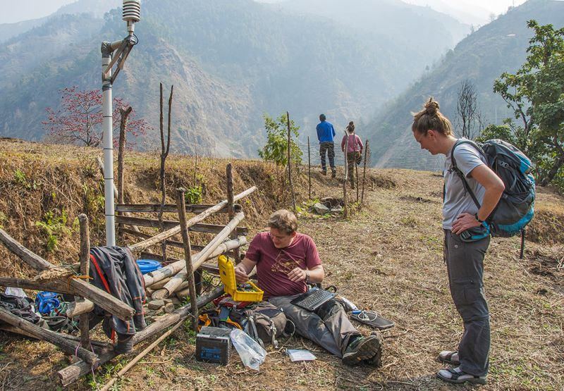 The scientists check a wireless seismometer and weather station near Chaku. Such deployments aim to track changes in ground properties and their responses to earthquake aftershocks and rainfall
