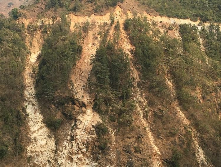Landslide scars run down from a poorly built road near Mirmee in central Nepal like frozen waterfalls. The proliferation of road construction without proper slope stabilisation has contributed to the rise in landslides in recent years