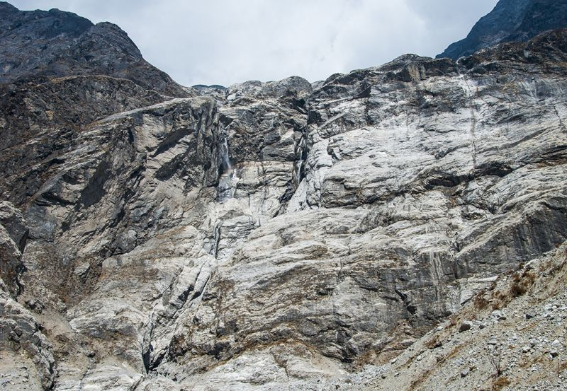 The stream pouring down the rock face overlooking the buried villages of Langtang Valley has been getting stronger in recent years. Locals also notice increasingly frequent rockfall. These match the hypothesis that climate change might be priming the landscape for the devastation