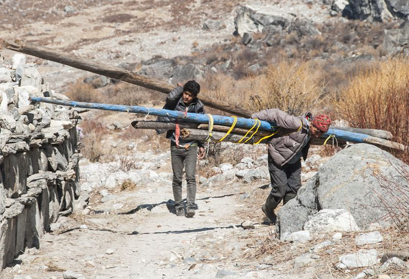 Porters carry construction materials to Langtang Valley, which is accessible only by foot. It takes about three days to walk from the nearest town to the village of Langtang, making quake recovery extremely expensive and challenging