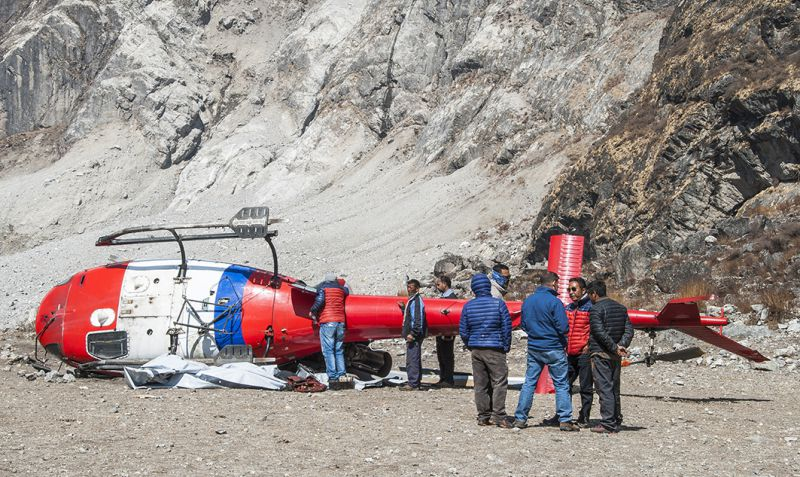 A helicopter, sponsored by NGOs to transport construction materials to Langtang villages, toppled over on the landslide debris. It was the only chopper in Nepal that could carry heavy loads and navigate complex terrain