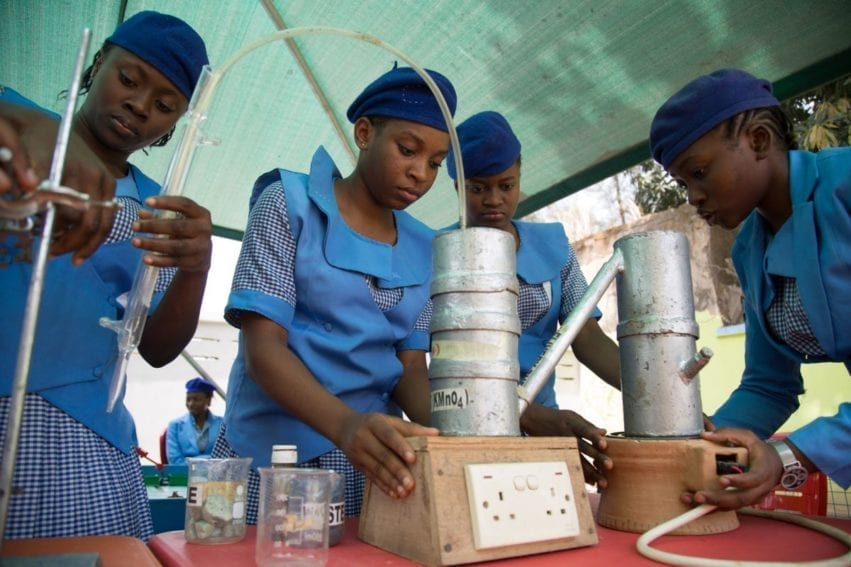 Pupils from Government Girls Secondary School Dutse work on their science project aimed at extracting harmful chemicals from non-biodegradable waste and turning the rest into fuel. Fifteen-year-old Audam Peace (far left) wants to become a gynaecologist. She says determination matters most to achieving any goal