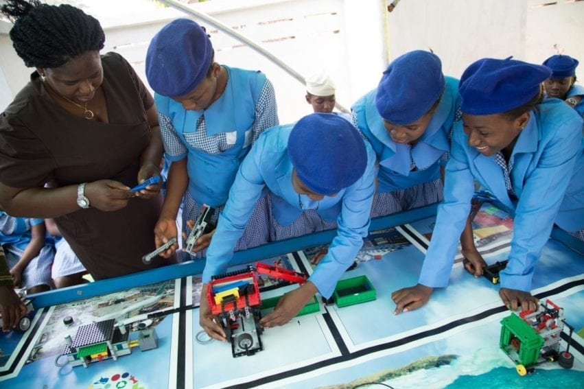 Stella Uzochukwu-Denis from the Odyssey Educational Foundation shows girls from Government Girls Secondary School Dutse how to build a robot.The foundation hosted the First Lego League challenge, in Abuja. In this competition, students programmed Lego robots donated by the toy firm to achieve a waste-based goal
