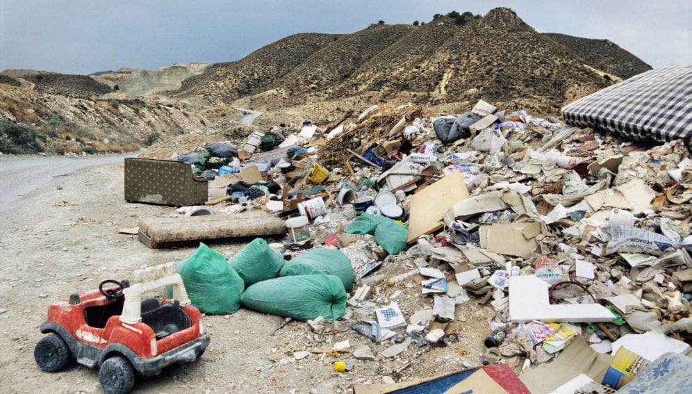 Waste from a construction site is dumped in the mountains