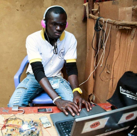 Demou-Kay, a Congolese refugee, running his radio station in Nakivale settlement. It is the only station in Nakivale, and is staffed by a team of young refugees, alongside Demou-Kay.