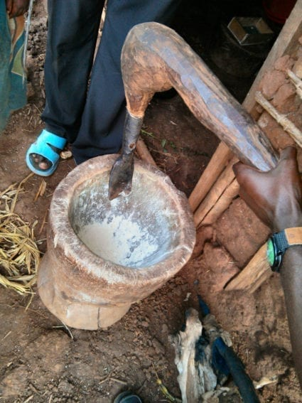 A traditional Congolese cassava grinder crafted by a refugee using handmade tools in Kyangwali refugee settlement. The refugee now makes a living selling these wooden grinders to other Congolese refugees in Kyangwali.