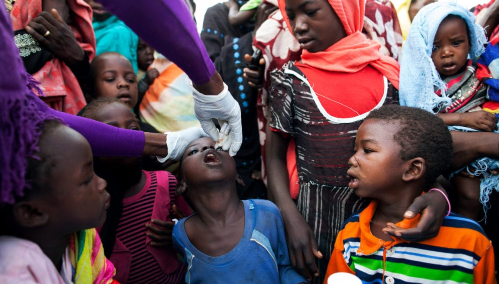 A nurse from the NGO World Vision provides polio vaccination