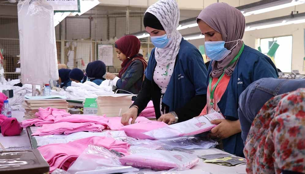 Syrian and Jordanian women employed in a garment factory in one of Jordan's industrial zones