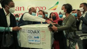 Boosters condemned as COVAX reins in supply forecast