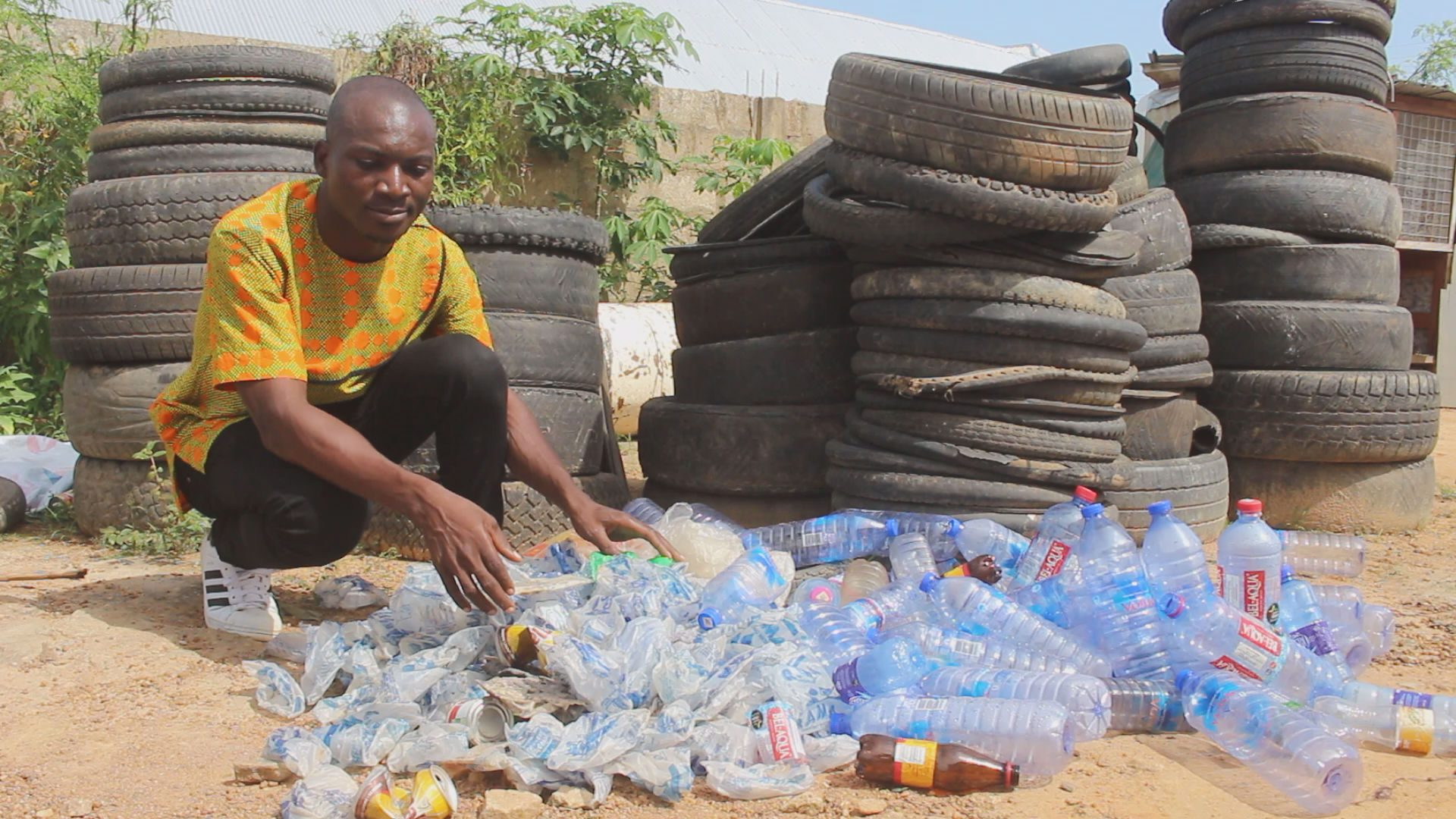 Picture 1-Francis Kantavooro sorting out plastic bottles at his factory 1