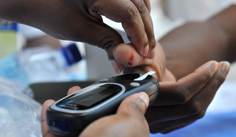 Community members get tested for sicknesses such as high blood pressure and diabetes