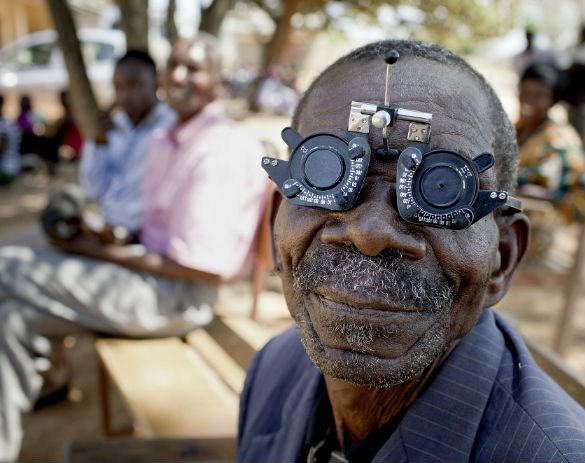 patient wearing an sight measuring device as a doctor