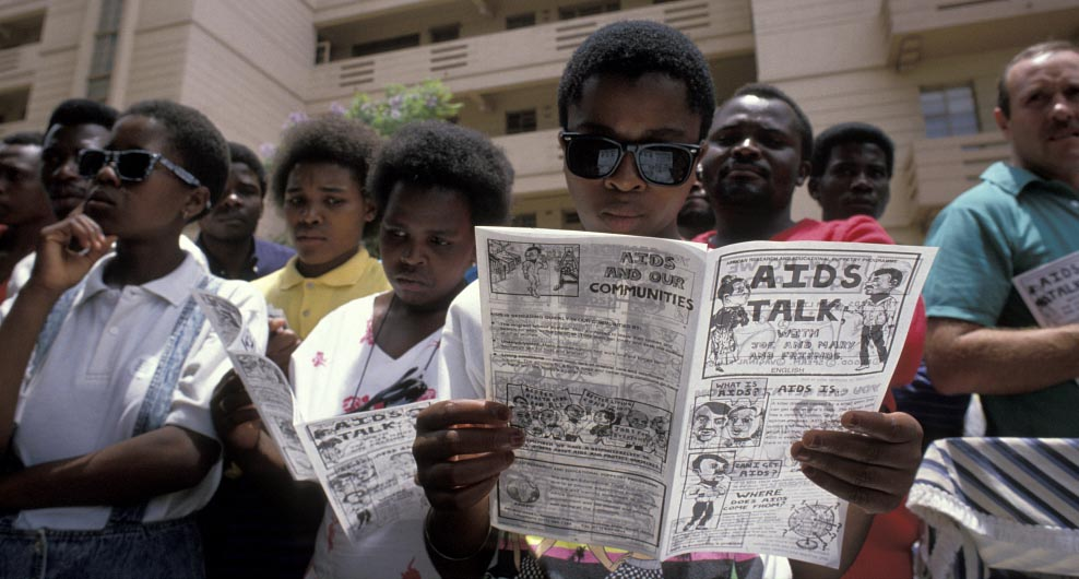 AIDS education. Before each performance of the 'Puppets against AIDS' theatre group, the audience are given information pamphlets in various local languages.
