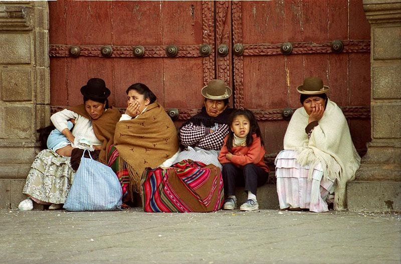 Women and children around the Cathedral dressed in traditional clothes. La Paz, Bolivia