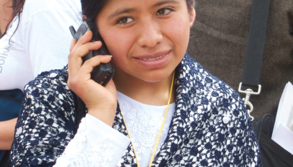 Bolivian on Phone_Flickr_The City Project