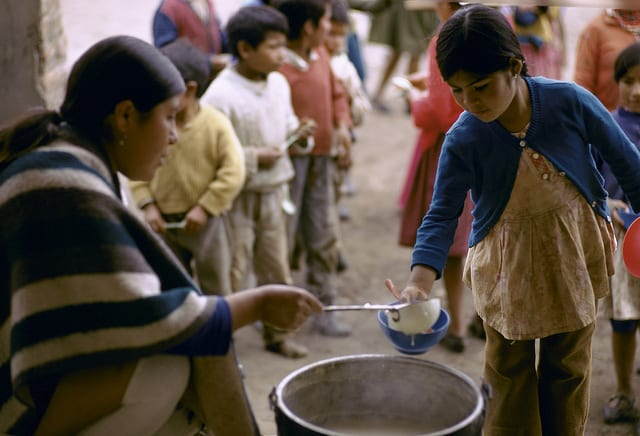 children in line waiting for meal, ecuador