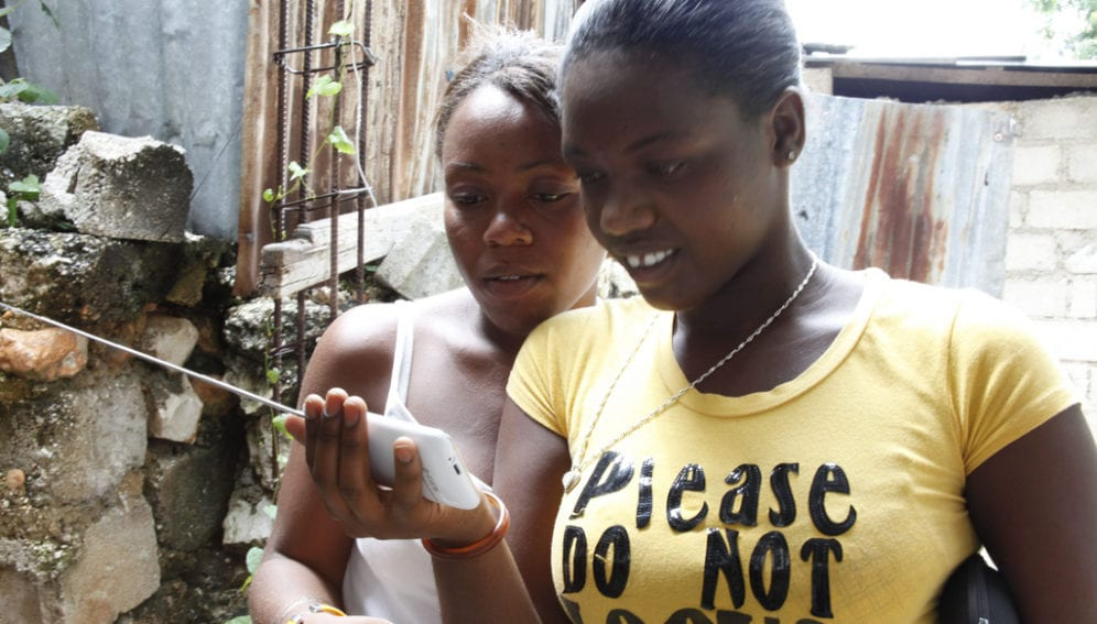 Using Phone after Haiti Earthquake_Flickr_Russell Watkins_Department for International Development