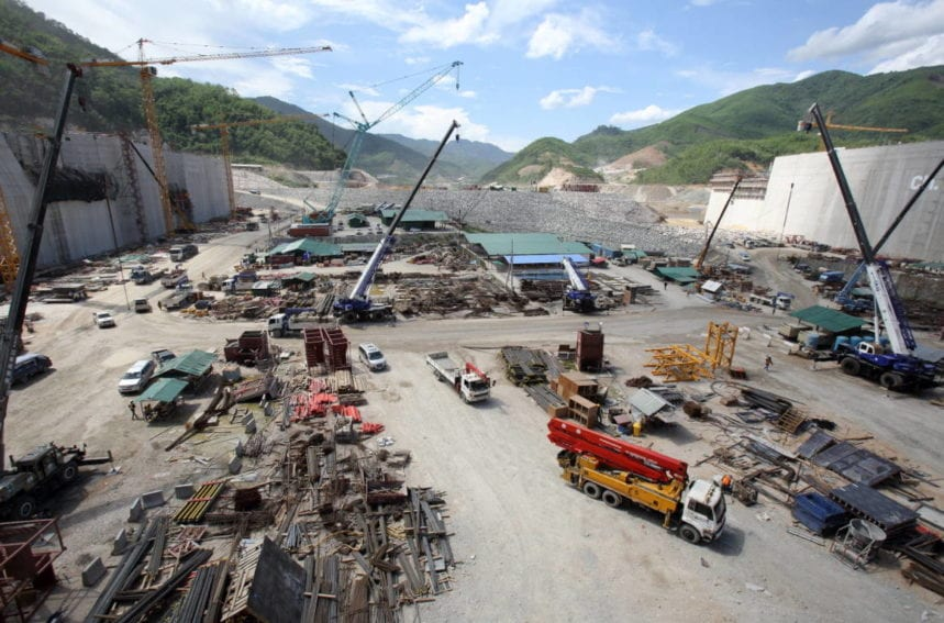 The Xayaburi Dam on the Mekong River dwarfs the construction vehicles building it. It is due to open in 2019 and cost around US$3.5 billion