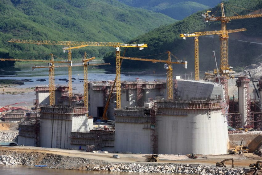 Cranes tower over the gates that will eventually regulate the flow of the Mekong, the world's 12th longest river, letting through almost 4,000 cubic metres of water each second. The dam is expected to generate up to 1,285 megawatts of power