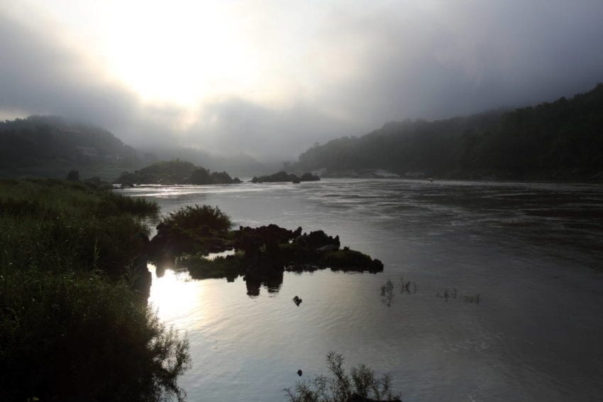 The Mekong in the early morning, upstream of the dam site near the popular tourist town of Luang Prabang. The dam is in a picturesque area and there are concerns that it will deter tourists