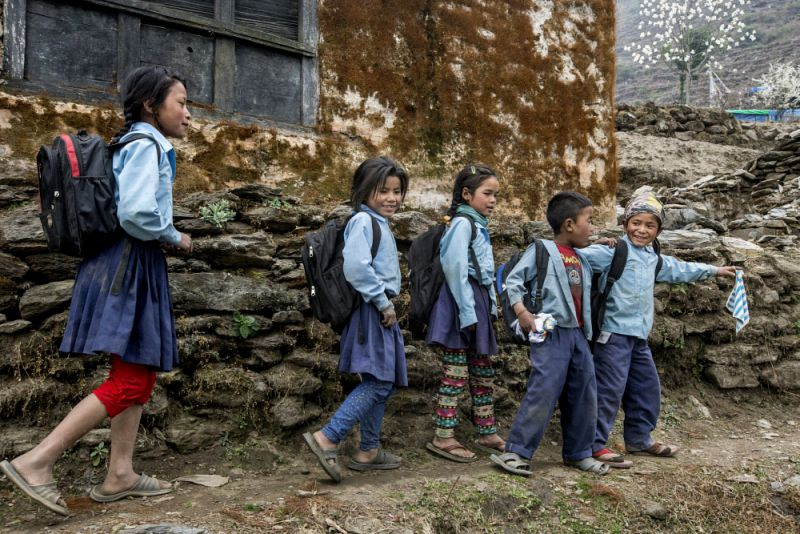 Nepalese children on their way back from a makeshift school