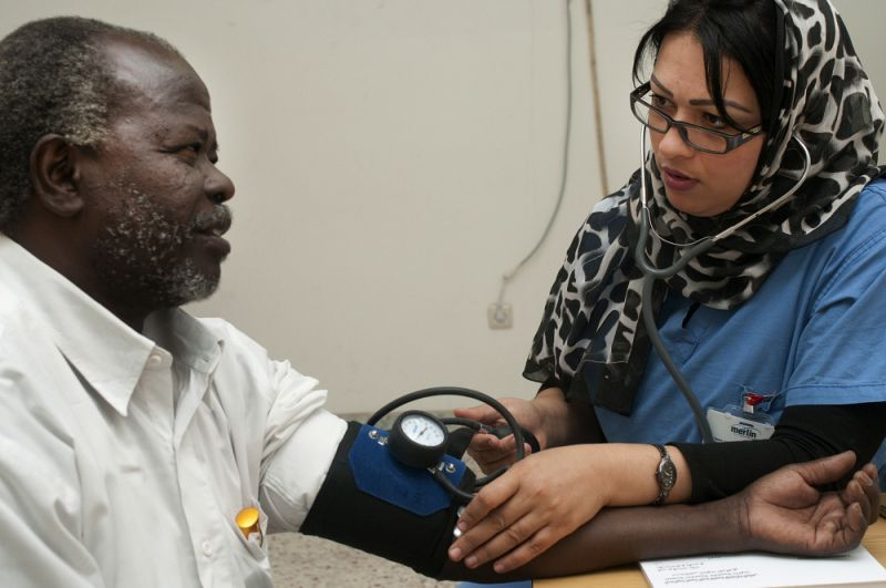 Tunisian doctor takes the blood pressure