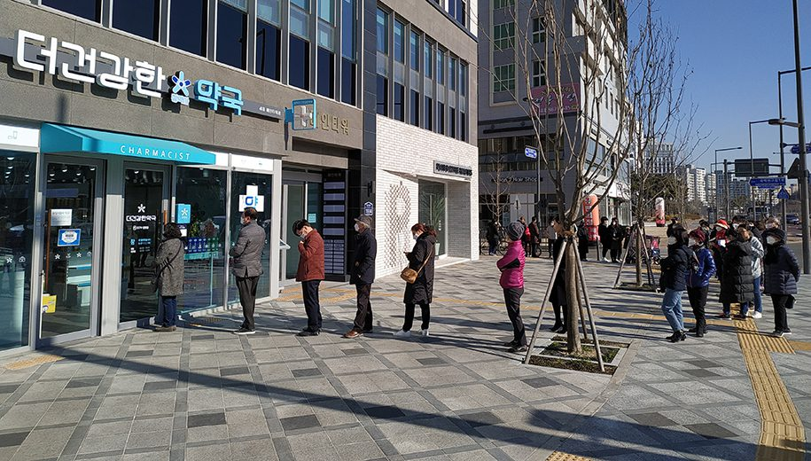 Line at a pharmacy in South Korea - main