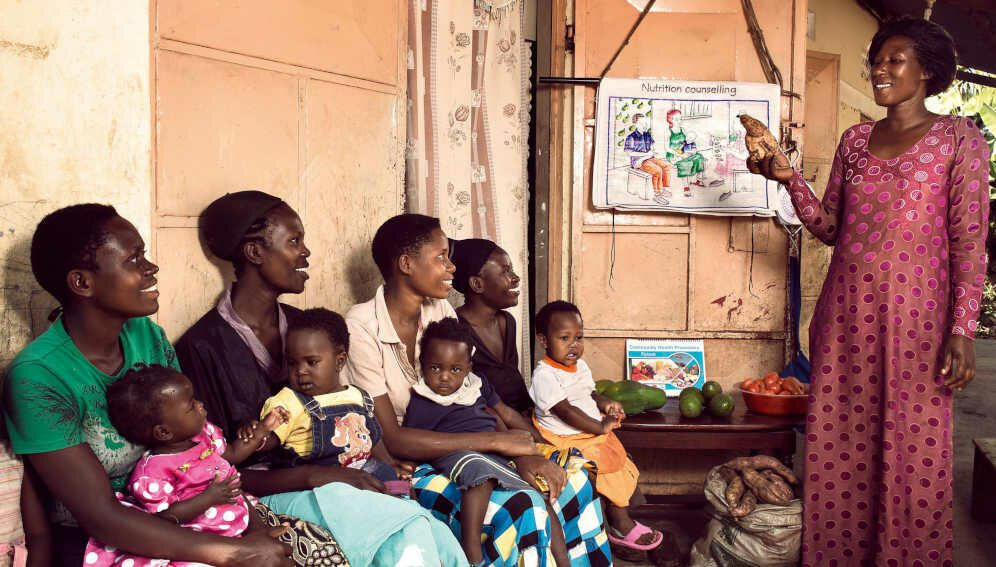 Betty Nabiteeko, 38, teaches mothers with small children about nutrition at her home near Mityebili, Uganda.