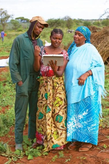 The power of ICT: One of the farmers trained by Farm Africa is using a tablet computer to train others farmers in growing improved sesame in Tanzania
