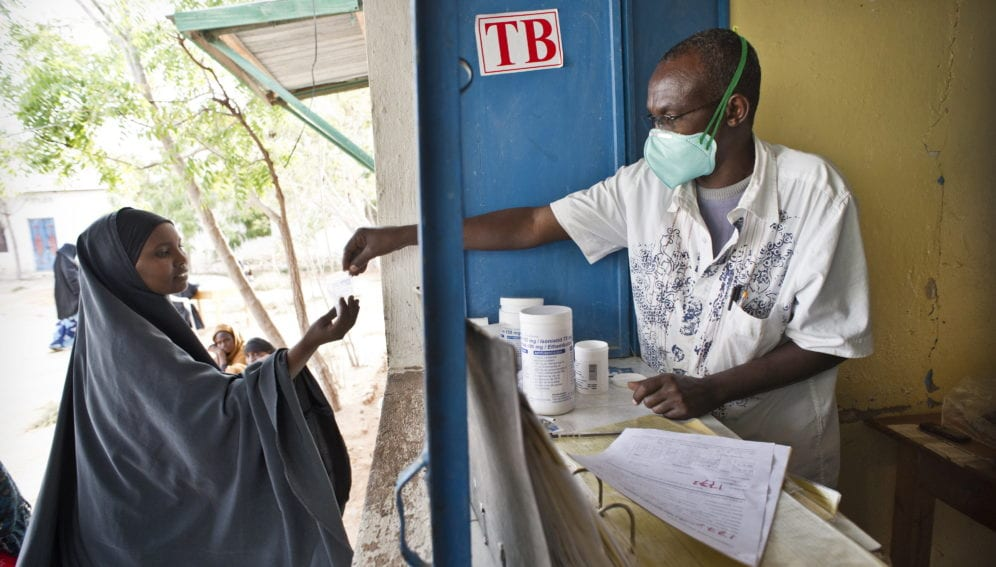 An outpatient collects her TB medicine from Galcayo hospital's dispensery