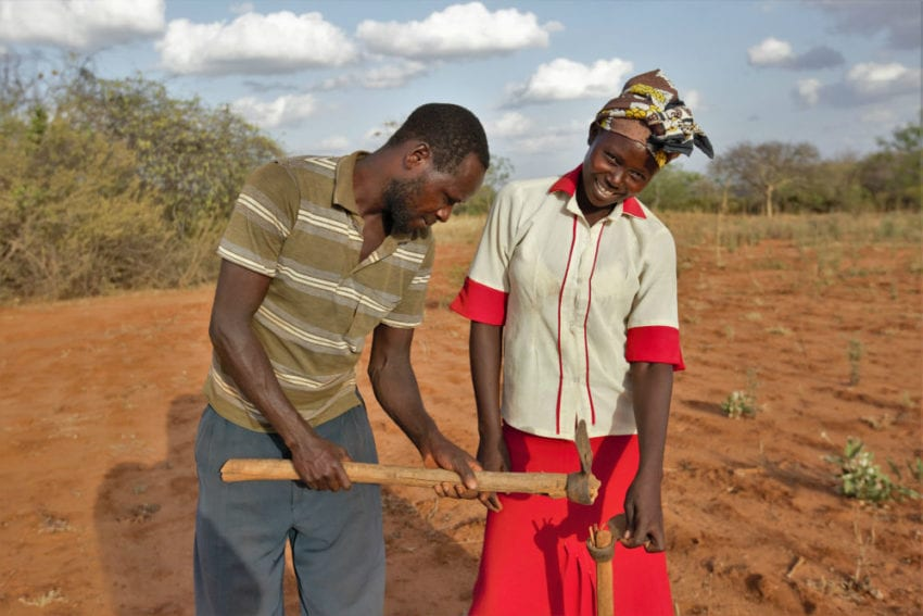 Peter and hiw wife, Mary, who are smallholder farmers in Mwingi are preparing their farm using lessons learnt from the trainings