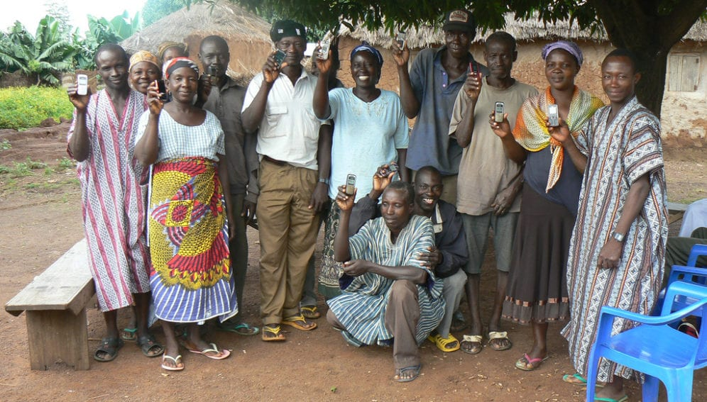 Farmers with mobile phones that they use to look up price information about their crops